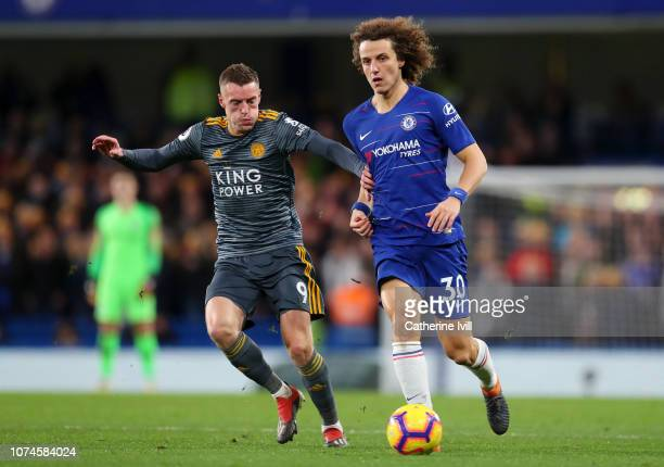 David Luiz of Chelsea is challenged by Jamie Vardy of Leicester City during the Premier League match between Chelsea FC and Leicester City at...