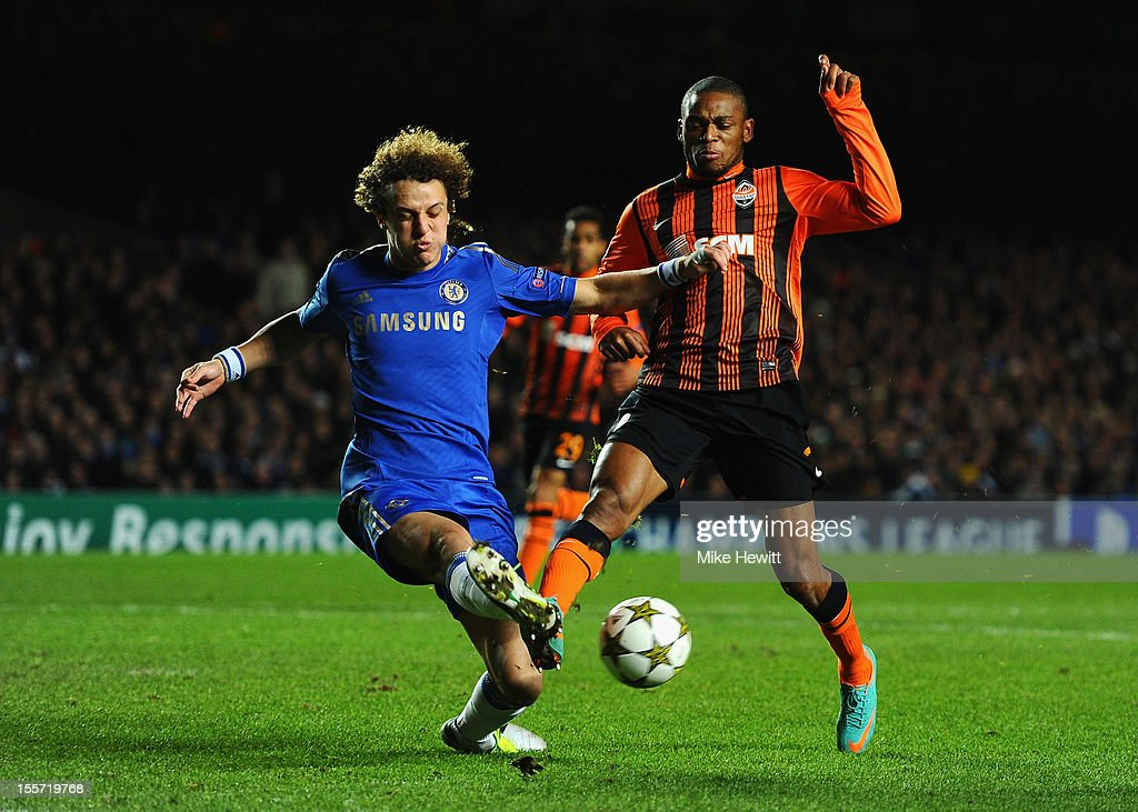 David Luiz of Chelsea is challenged by Luiz Adriano of Shakhtar Donetsk during the UEFA Champions League Group E match between Chelsea and Shakhtar Donetsk at Stamford Bridge on November 7, 2012 in London, England.