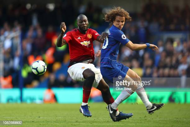 David Luiz of Chelsea is challenged by Romelu Lukaku of Manchester United during the Premier League match between Chelsea FC and Manchester United at...