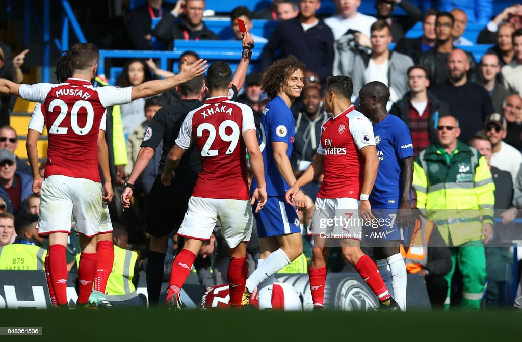 David Luiz of Chelsea is shown a red card and sent off during the Premier League match between Chelsea and Arsenal at Stamford Bridge on September 17, 2017 in London, England.