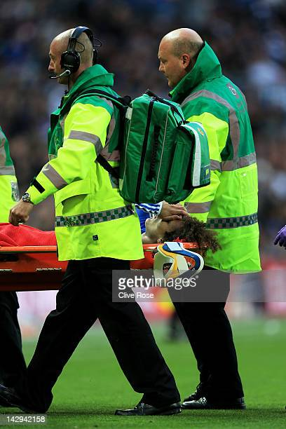 David Luiz of Chelsea is stretchered off during the FA Cup with Budweiser Semi Final match between Tottenham Hotspur and Chelsea at Wembley Stadium...