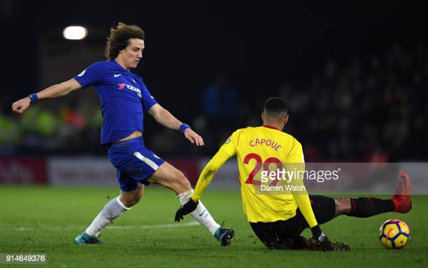 David Luiz of Chelsea is tackled by Etienne Capoue of Watford during the Premier League match between Watford and Chelsea at Vicarage Road on...