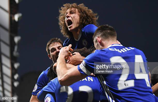 David Luiz of Chelsea joins the celebration after Willian scoring their team's third goal during the Premier League match between Chelsea and Stoke...