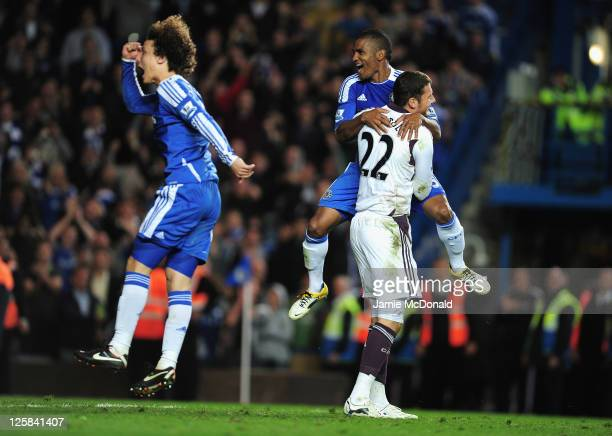 David Luiz of Chelsea jumps for joy as team mate Florent Malouda celebrates with goalkeeper Ross Turnbull after a penalty shootout victory during the...