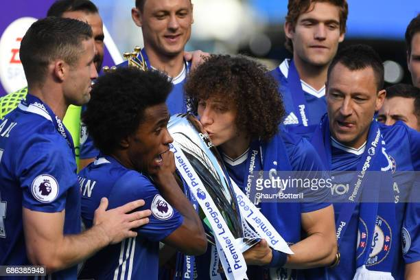 David Luiz of Chelsea kisses the Premier League Trophy after the Premier League match between Chelsea and Sunderland at Stamford Bridge on May 21...