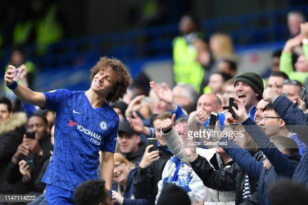 David Luiz of Chelsea poses for photographs the fans after the Premier League match between Chelsea FC and Watford FC at Stamford Bridge on May 05...