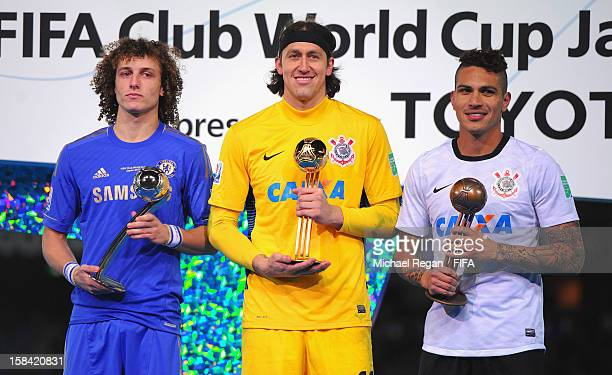 David Luiz of Chelsea poses with the Adidas Silver Ball Award Cassio of Corinthians poses with the Adidas Golden Ball award and Paulo Guerrero of...