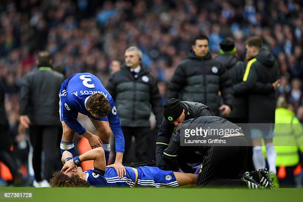 David Luiz of Chelsea receives a medical treatment after fouled by Sergio Aguero of Manchester City during the Premier League match between...