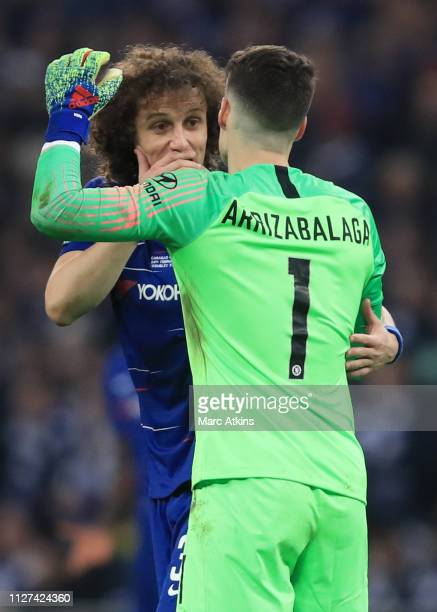 David Luiz of Chelsea relies to encourage Kepa Arrizabalaga to leave the pitch as Maurizio Sarri manager of Chelsea attempts to replace him with...