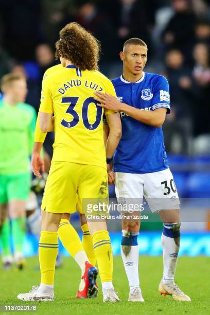 David Luiz of Chelsea shakes hands with Richarlison of Everton after the Premier League match between Everton FC and Chelsea FC at Goodison Park on...