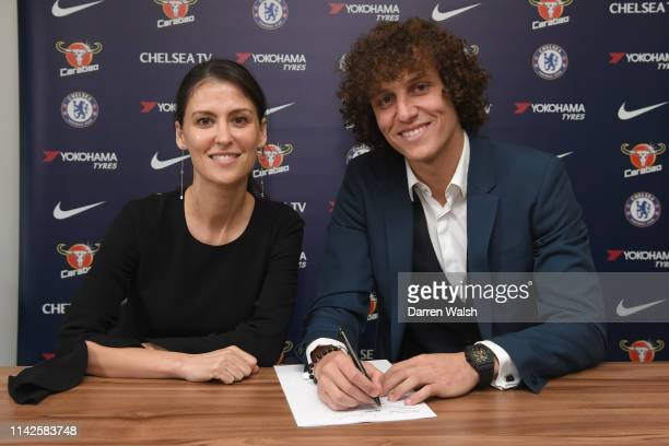 David Luiz of Chelsea signs a contract extension with Chelsea FC with Chelsea Director Marina Granovskaia at Stamford Bridge on May 10 2019 in London...