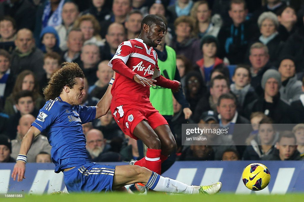 David Luiz of Chelsea tackles Shaun Wright Phillips of Queens Park Rangers during the Barclays Premier League match between Chelsea and Queens Park Rangers at Stamford Bridge on January 2, 2013 in London, England.