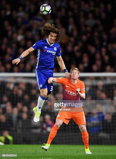 David Luiz of Chelsea wins a header over Kevin De Bruyne of Manchester City during the Premier League match between Chelsea and Manchester City at...