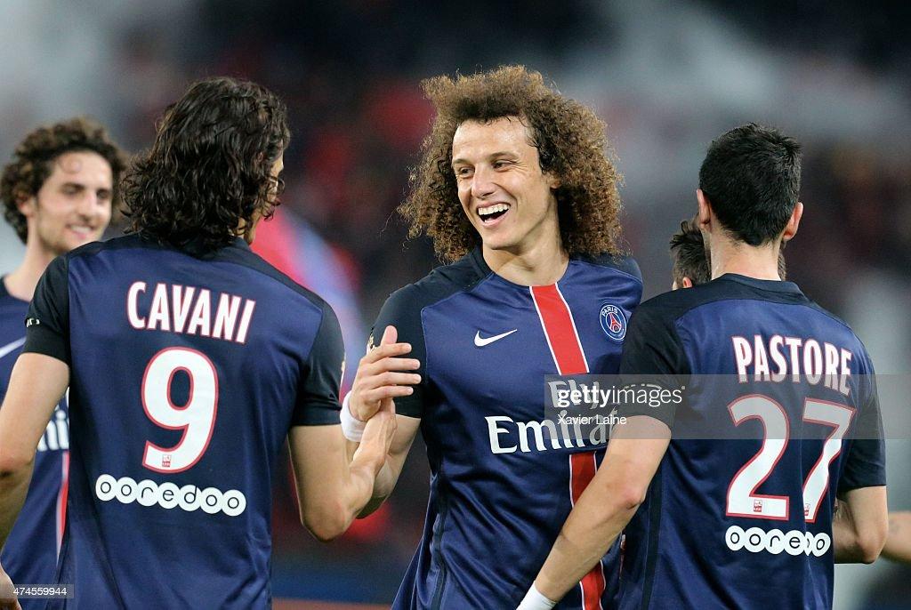 David Luiz of Paris Saint-Germain celebrate a goal by Edinson Cavani during the French Ligue 1 between Paris Saint-Germain FC and Stade de Reims at Parc Des Princes on may 23, 2015 in Paris, France.