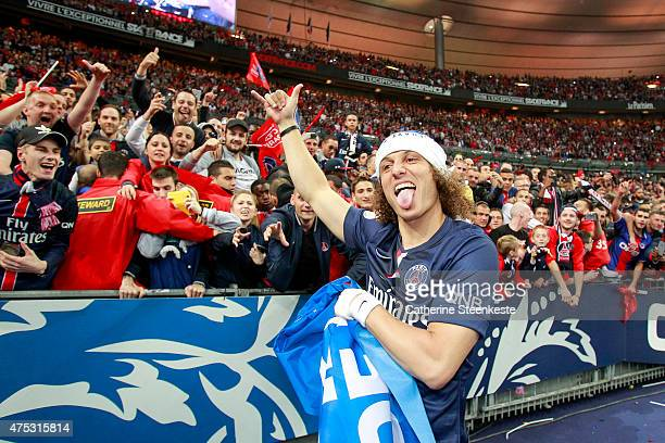 David Luiz of Paris SaintGermain celebrates with the fans the victory of the French Cup Final between AJ Auxerre and Paris SaintGermain at Stade de...