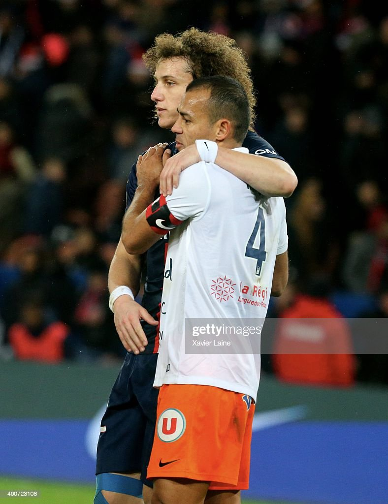 David Luiz of Paris Saint-Germain is disapointed and Hilton of Montpellier Herault SC celebrates after the French Ligue 1 between Paris Saint-Germain FC and Montpellier Herault SC at Parc Des Princes on December 20, 2014 in Paris, France.