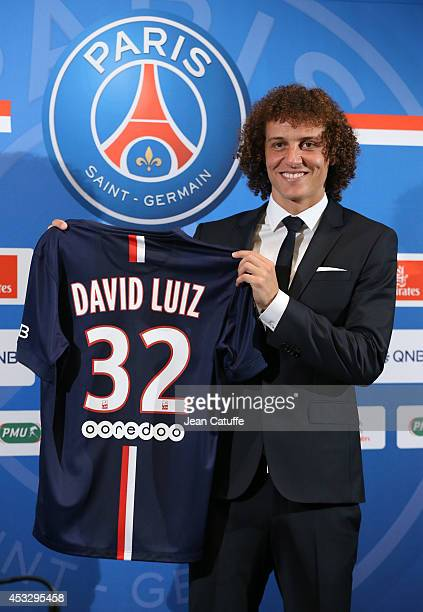 David Luiz of Paris SaintGermain presents his new jersey during his official presentation after signing for PSG at The Peninsula Hotel on August 7...