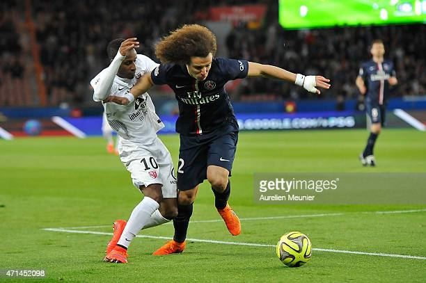 David Luiz of PSG and Bouna Sarr of Metz in action during the Ligue 1 game between Paris Saint Germain and Metz at Parc des Princes on April 28 2015...