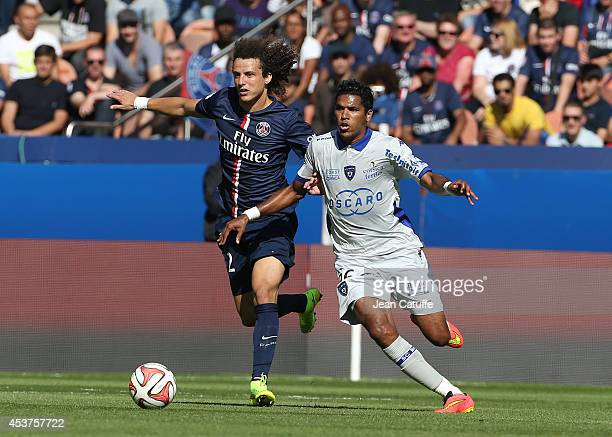 David Luiz of PSG and Brandao of Bastia in action during the French Ligue 1 match between Paris Saint Germain FC and SC Bastia at Parc des Princes...