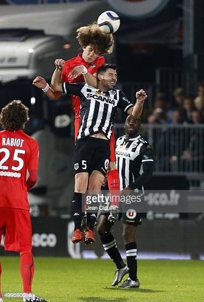 David Luiz of PSG and Thomas Mangani of SCO Angers in action during the French Ligue 1 match between Angers SCO and Paris SaintGermain at Stade Jean...