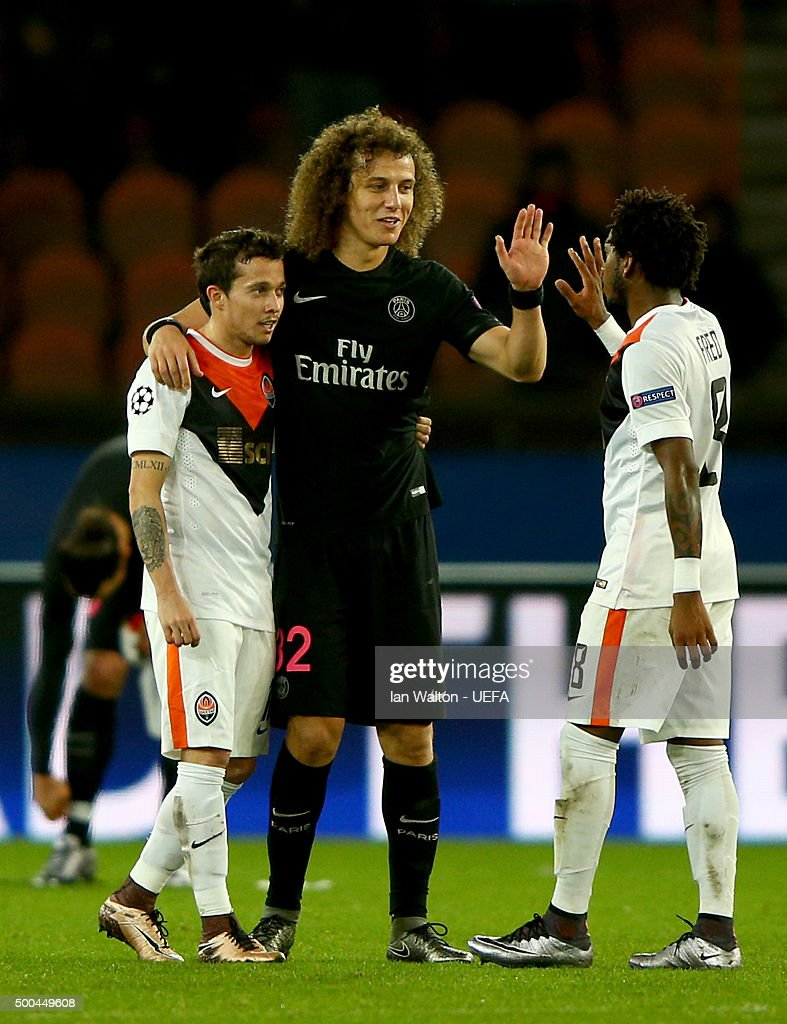 David Luiz of PSG is congratulated by Fred of Shakhtar after victory in the UEFA Champions League Group A match between Paris Saint-Germain and FC Shakhtar Donetsk at Parc des Princes on December 8, 2015 in Paris, France.
