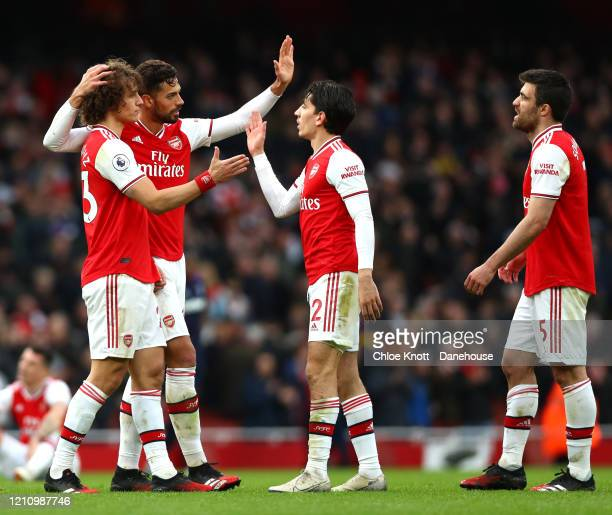 David Luiz Pablo Mari Hector Bellerin and Sokratis of Arsenal celebrate after winning the Premier League match between Arsenal FC and West Ham United...