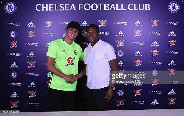 David Luiz poses with Michael Emenalo Technical Director as Luiz is unveiled as Chelsea's new signing at Chelsea Training Ground on August 31 2016 in...