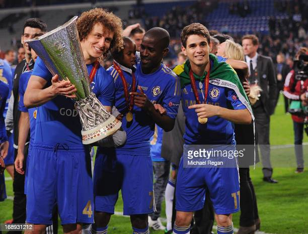 David Luiz Ramires and Oscar of Chelsea pose with the trophy during the UEFA Europa League Final between SL Benfica and Chelsea FC at Amsterdam Arena...