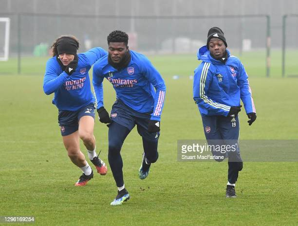 David Luiz, Thomas Partey and Nicolas Pepe of Arsenal during a training session at London Colney on January 13, 2021 in St Albans, England.
