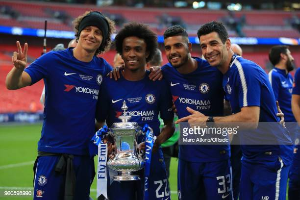 David Luiz Willian Emerson Palmieri and a member of coaching staff pose with the trophy during The Emirates FA Cup Final between Chelsea and...