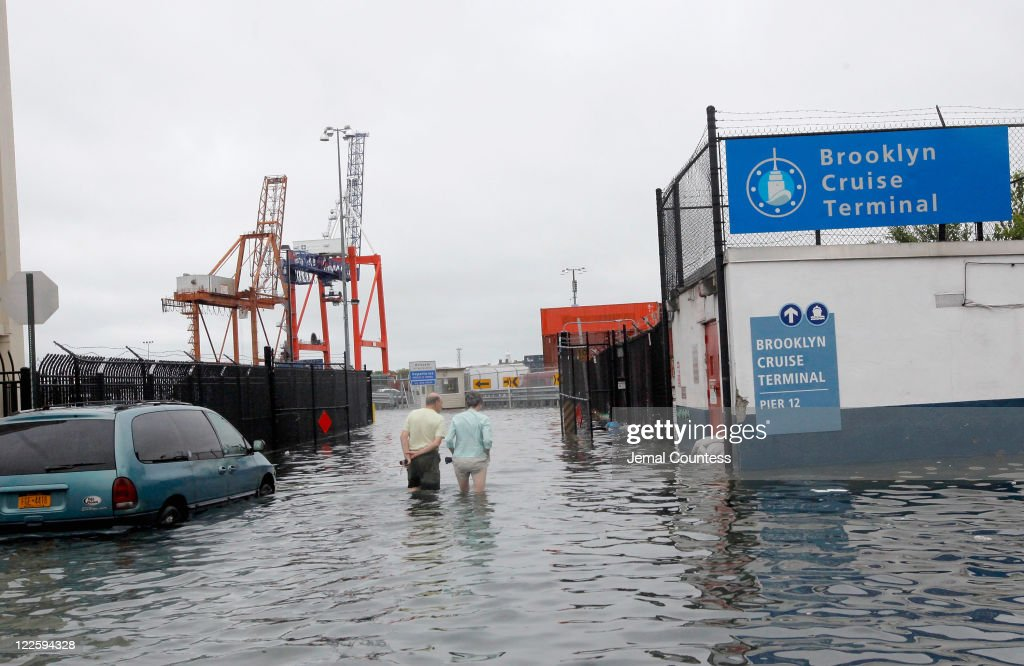 David Lutz and Lee Connors wade through water over two feet deep as they inspect parts of their Red Hook neighborhood in the aftermath of Hurricane Irene on August 28, 2011 in the Brooklyn borough of New York City. The hurricane hit New York as a Category 1 storm before being downgraded to a tropical storm.