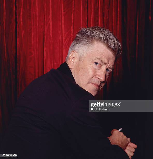 David Lynch in Front of Red Curtain