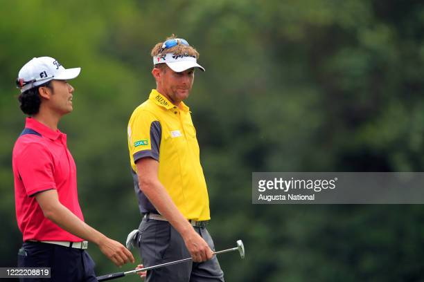 David Lynn of England and playing partner Kevin Na walk to the No. 12 green during Round 1 for the 2013 Masters.
