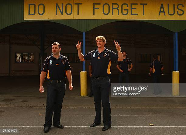 David Lyons and Daniel Vickerman of the Wallabies have their photo taken at the Victoria School following a commemorative service at the Australian...