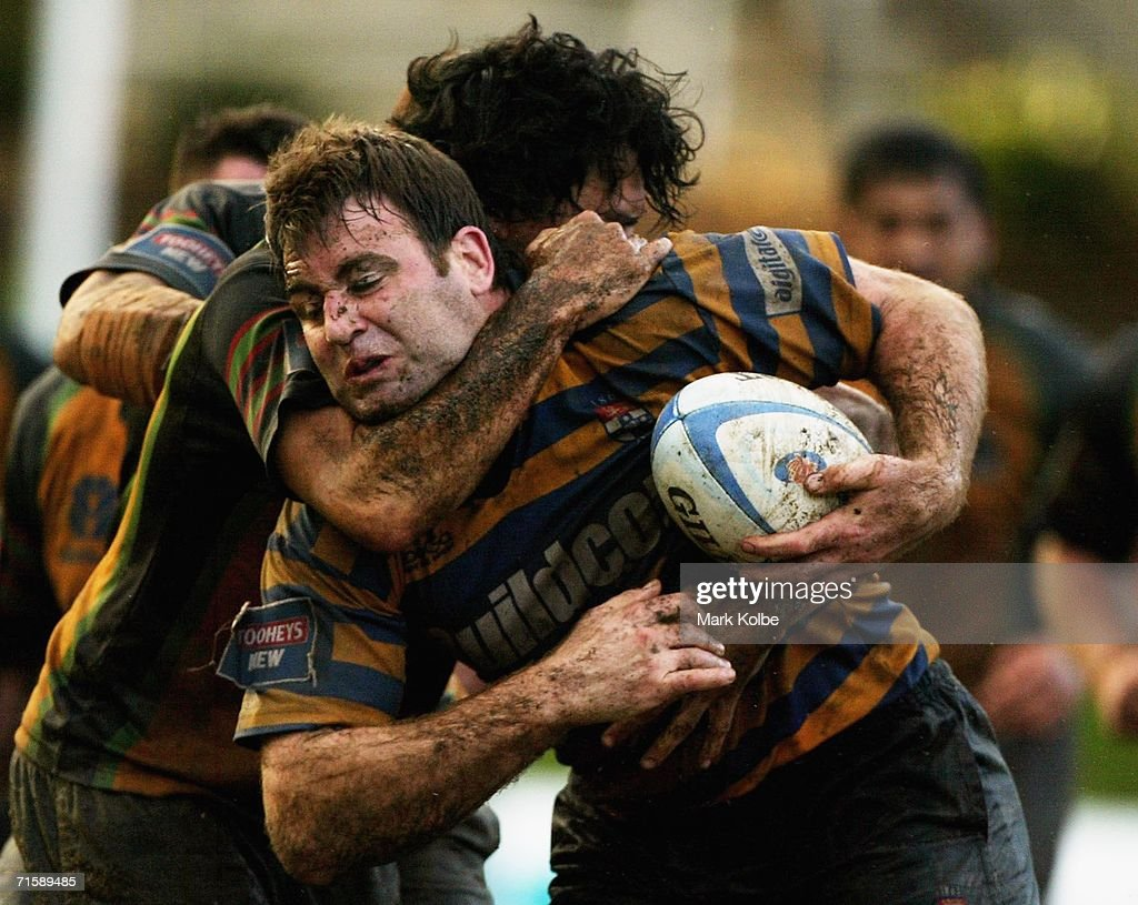 David Lyons of Sydney University is tackled high in action during the Tooheys New Cup Round 10 match between Sydney University and Penrith at Sydney University Oval, August 5, 2006 in Sydney, Australia.
