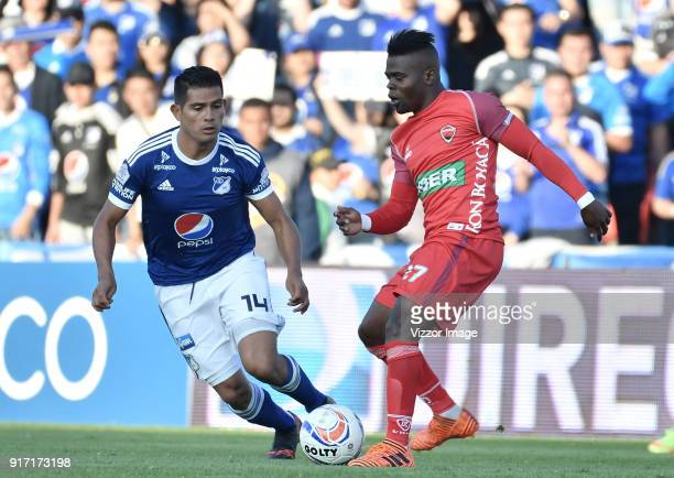 David Macalister Silva of Millonarios fights for the ball with Carlos Mosquera of Patriotas Boyaca during a match between Millonarios and Patriotas...
