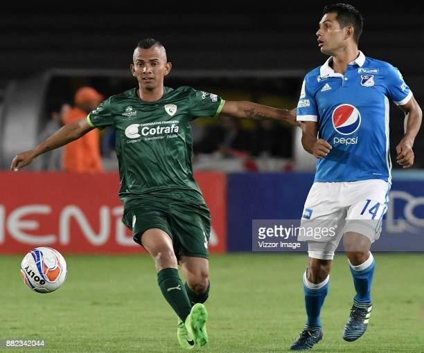 David Macalister Silva of Millonarios fights for the ball with Breiner de Alba of La Equidad during the second leg match for the quarterfinals of the...