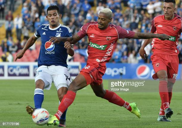 David Macalister Silva of Millonarios fights for the ball with Azmahar Ariano of Patriotas Boyaca during a match between Millonarios and Patriotas...