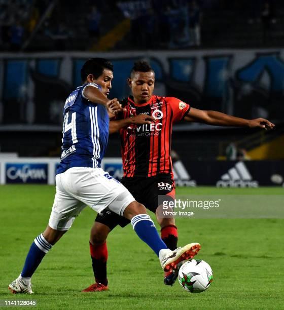 David Macalister Silva of Millonarios vies for the ball with Luis Miranda of Cucuta Deportivo, during a match between Millonarios and Cúcuta as part...