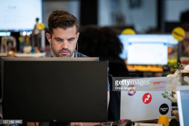 David Mack deputy director of breaking news works at his desk at BuzzFeed headquarters December 11 2018 in New York City BuzzFeed is an American...