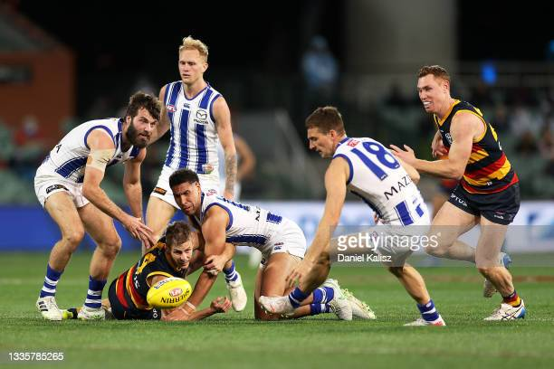 David Mackay of the Crows and Tom Lynch of the Crows compete for the ball during the round 23 AFL match between Adelaide Crows and North Melbourne...