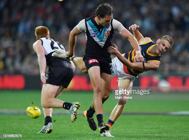 David Mackay of the Crows bumped off the ball by Steven Motlop of Port Adelaide during the round eight AFL match between the Port Adelaide Power and...