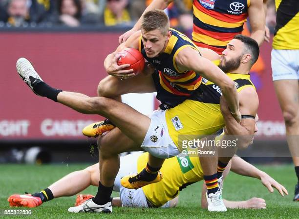 David Mackay of the Crows is tackled by Shane Edwards of the Tigers during the 2017 AFL Grand Final match between the Adelaide Crows and the Richmond...