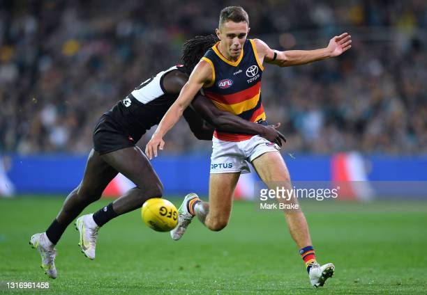 David Mackay of the Crows tackled by Martin Frederick of Port Adelaide during the round eight AFL match between the Port Adelaide Power and the...
