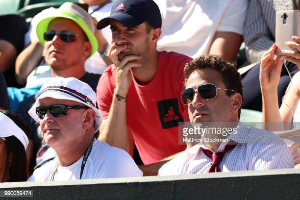 David Macpherson and Justin Gimelstob watch the Men's Singles first round match between Yannick Maden of Germany and John Isner of the United States...