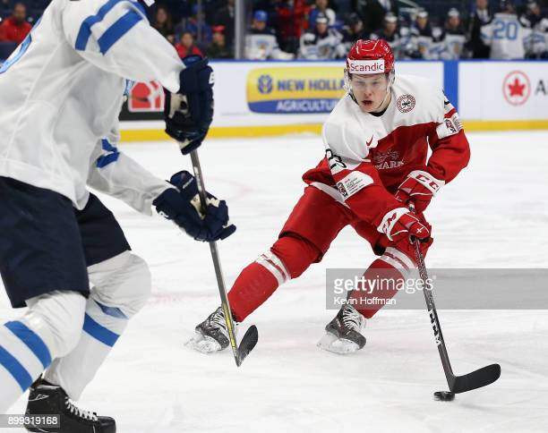 David Madsen of Denmark with the puck in the first period against Finland during the IIHF World Junior Championship at KeyBank Center on December 28...
