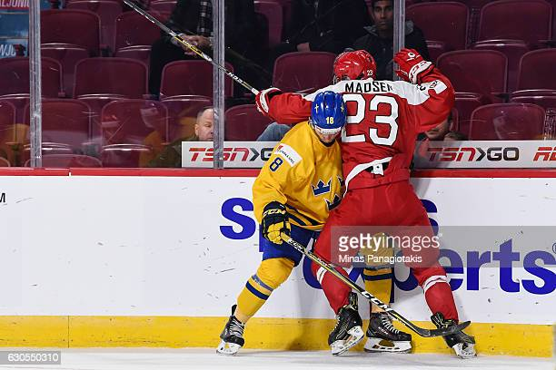 David Madsen of Team Denmark pins Rasmus Dahlin of Team Sweden against the boards during the IIHF preliminary round game at the Bell Centre on...