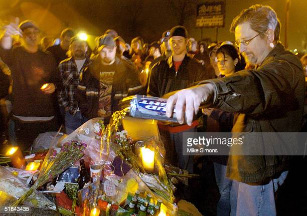 David Manning pours beer on a makeshift memorial outside of the Alrosa Villa Club on December 9, 2004 in Columbus, Ohio. According to authorities, a...