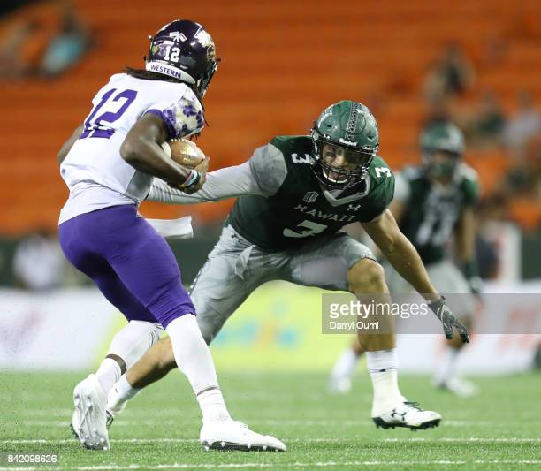 David Manoa of the Hawaii Rainbow Warriors attempts to tackle Tyrie Adams of the Western Carolina Catamounts in the third quarter of their game at...