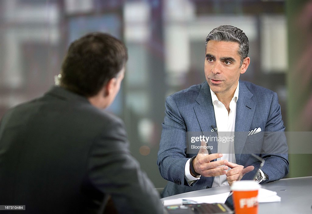 David Marcus, president of PayPal, a unit of EBay Inc., right, speaks during a Bloomberg Television interview in London, U.K., on Wednesday, April 24, 2013. EBay, based in San Jose, California, is expecting payment volume at PayPal to double in the next three years as people increasingly shop and pay for goods on mobile devices. Photographer: Simon Dawson/Bloomberg via Getty Images
